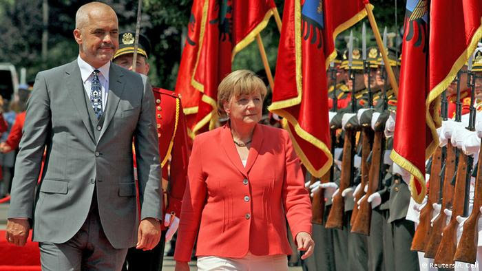 German Chancellor Angela Merkel (R) and Albania's Prime Minister Edi Rama inspect the honour guard during a welcome ceremony in Tirana, Albania, July 8, 2015 (Photo: REUTERS/Arben Celi)