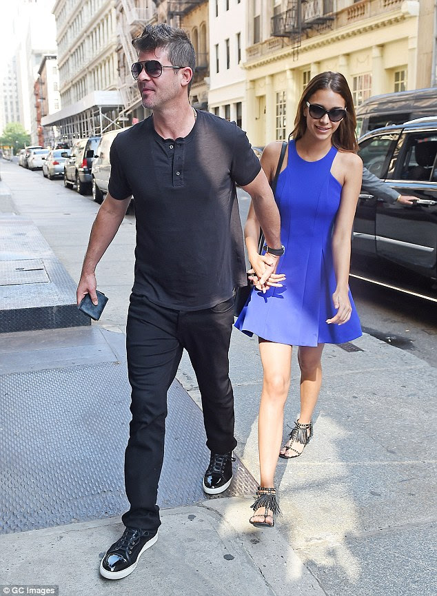 Still going strong: Despite their large age gap, the pair's romance has been going strong since they started dating in late 2014. They are seen together here in June of last year