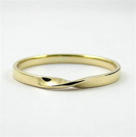 Not expensive Zsolt wedding rings: Mobius twist wedding ring