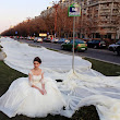 The world's longest wedding dress train is unveiled on a hot air balloon ride