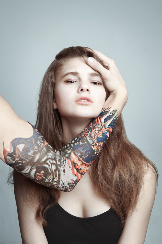 Girl And Male Hand With A Tattoo On Her Face Portrait Photos