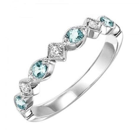 10k white gold diamond and blue topaz birthstone ring