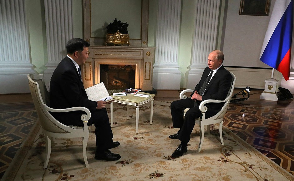 Ahead ofhis visit toPeople's Republic ofChina, thePresident ofRussia answered questions from President ofChina Media Group Shen Haixiong.