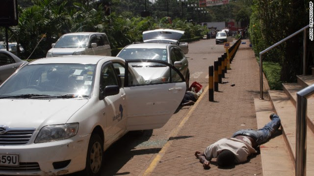 Bodies lie outside the shopping mall. A Kenyan government source and Western diplomatic sources say the attackers appear to be of Somali origin.