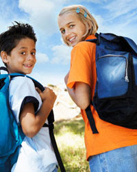 Two preteen students with backpacks