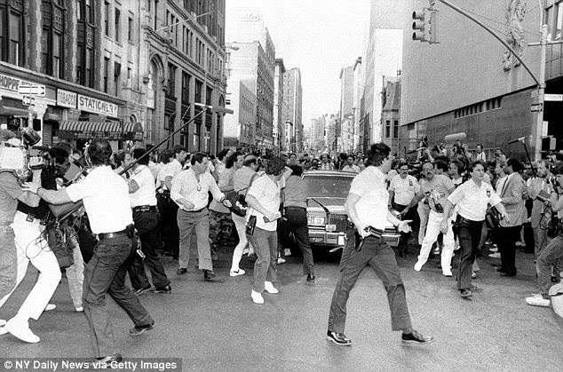 Here officers clear a path for limousine carrying Goetz from court. The shooting sparked a race debate in New York City