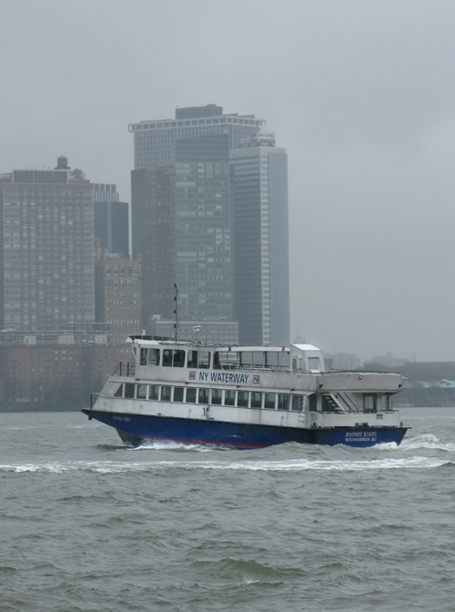 NY WATERWAY ferry on the rainy Hudson River with lower Manhattan, NYC