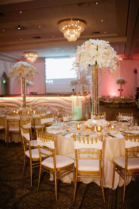 Tall centerpieces in white flowers, crystals & gold