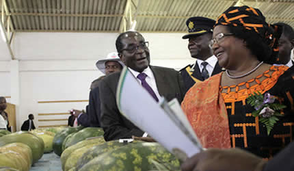 President Mugabe and his Malawian counterpart, Dr Joyce Banda, share a lighter moment while touring exhibition stands at the just-ended Zimbabwe International Trade Fair in Bulawayo on April 26, 2013. (Photo: Percy Musiiwa) by Pan-African News Wire File Photos