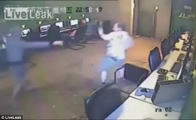 Merciless: The manager appears to try and get up after the beating, which happened at 11pm last Friday