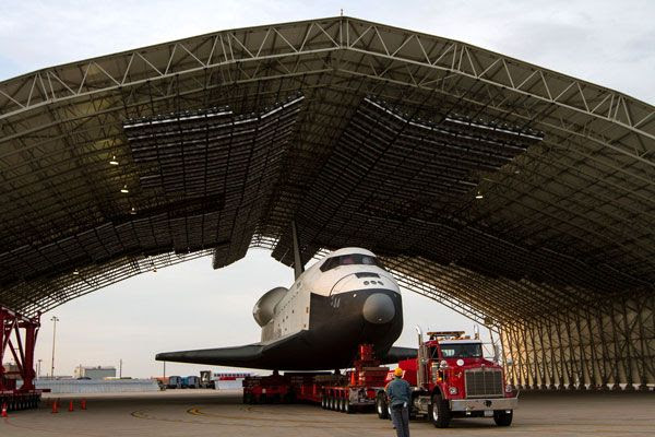 Enterprise is towed into a temporary hangar after being demated from NASA 905 at JFK International Airport, on May 12, 2012.