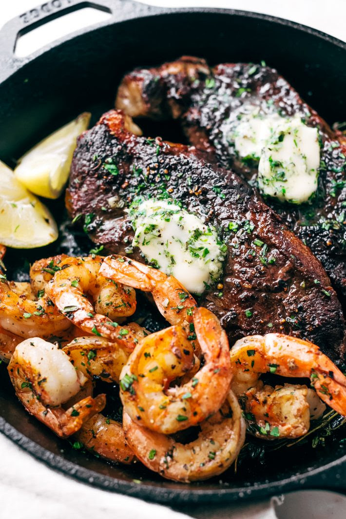 Garlic Butter Skillet Steak and Shrimp - tender cooked steak and juicy shrimp all smeared with homemade garlic butter. So easy to make and perfect for date night or even a weeknight dinner! #steakandshrimp #surfandturf #skilletsteak #pansearedsteak | Littlespicejar.com