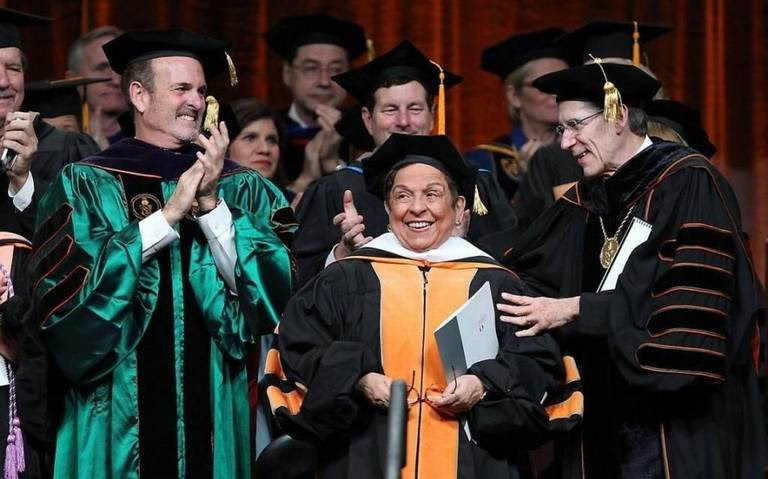Former University of Miami President Donna Shalala is applauded by University of Miami Board of Trustees Chair Stuart Miller and UM President Julio Frenk on Thursday, Dec. 15, 2016.