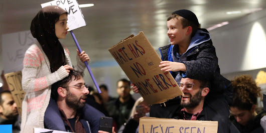 The Beautiful Story Behind This Viral Photo From A Chicago Airport Protest