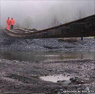 Rail engineers inspect a damaged rail line (Image: RGS)