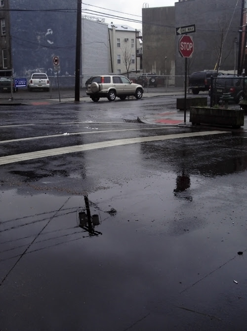 Rainy Intersection with reflection of power line