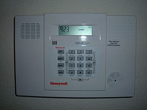 A Honeywell home alarm system control panel.
