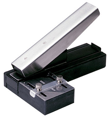 Slot hole punch for id cards