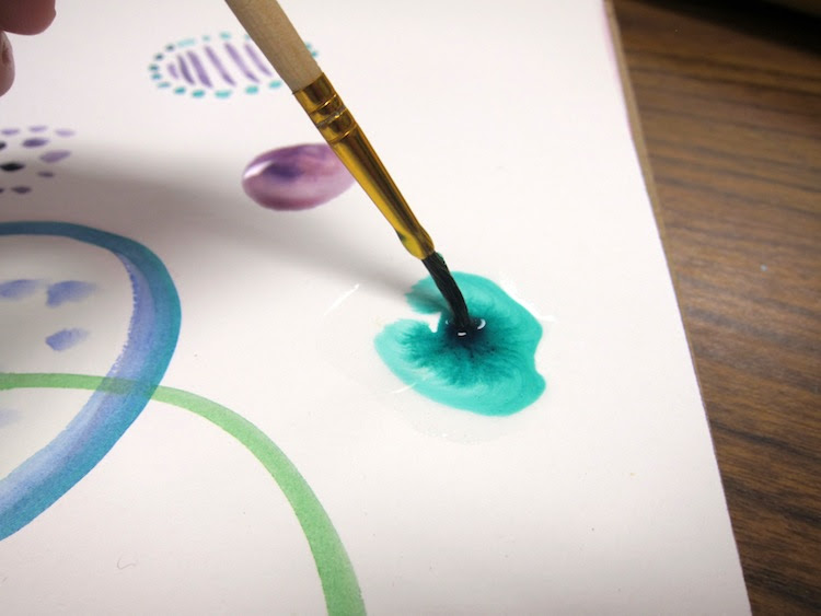Painting with watercolors in an art journal