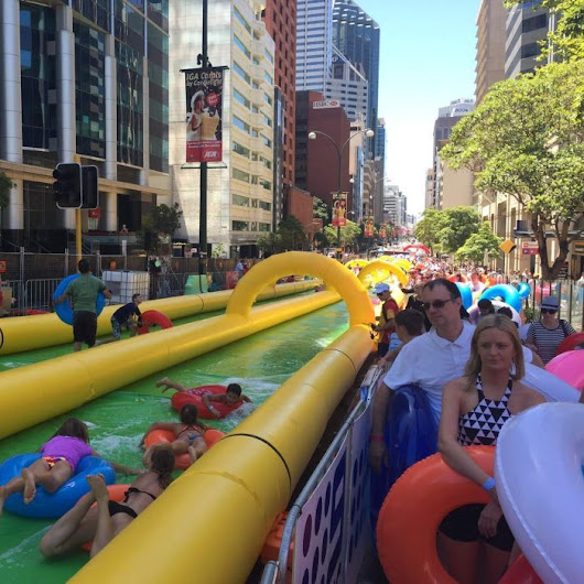 Crowds flock to giant water slide down city street