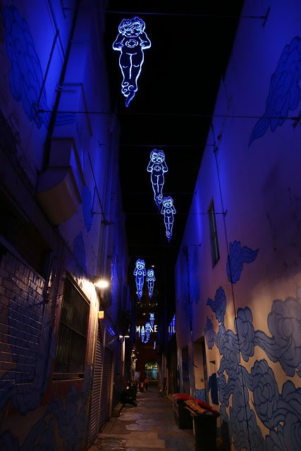 In Between Two Worlds (night time lighting) - Kimber Lane, City of Sydney Street Art