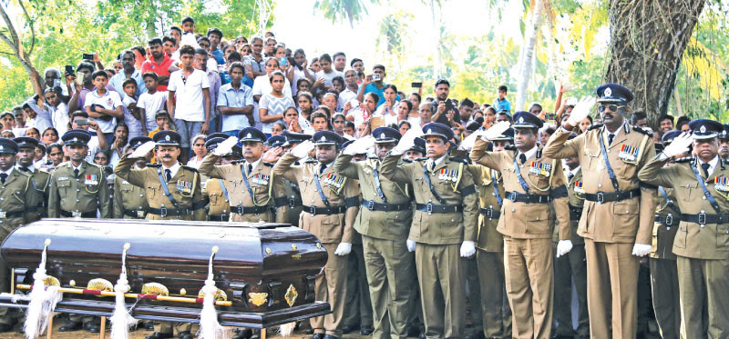 The Police Force pays their last respects to SI Sarath Hemachandra. Pictures by Rukmal Gamage