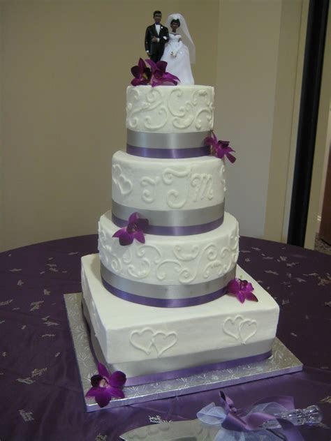 Four tier square and round wedding cake with purple and