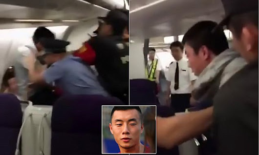 Chinese footballer and wife dragged off plane in handcuffs | Daily Mail Online