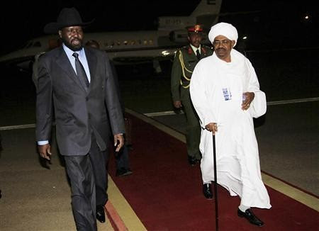 Silva Kir, the leader of south Sudan and President Omar al-Bashir of Sudan. The President said he would recognize the south if it voted for separation from the central government. Factional fighting in the south may jeopardize their independence. by Pan-African News Wire File Photos