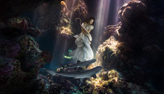 Model Tied Down In Underwater Cave with Sharks Creates Stunning Imagery | Fstoppers