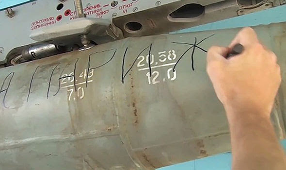 Russian soldiers write on bombs destined for ISIS