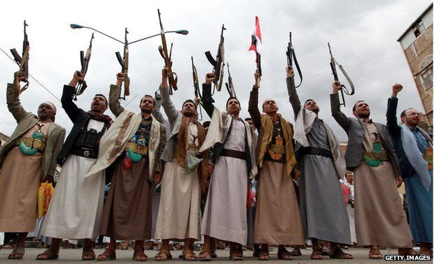 Tribal gunmen loyal to the Houthi movement brandish their weapons on 26 March, 2015