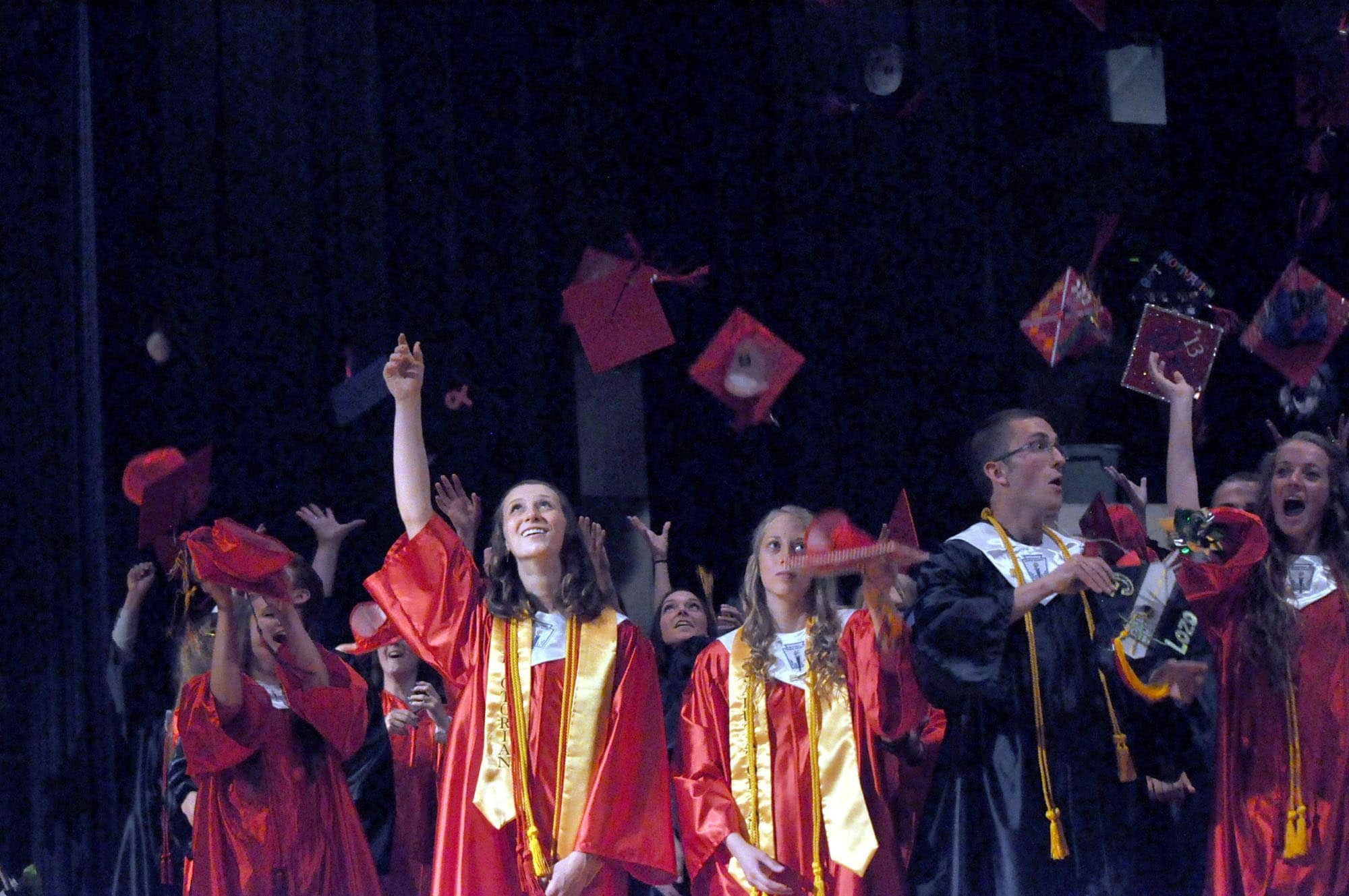 Sayre High School's graduating class tosses their caps in the air at the end of the graduation on Friday, June 7, 2013, in Sayre, Pa. The high school graduated 61 seniors this year. (AP Photo/The Daily Review, Brian Fees)