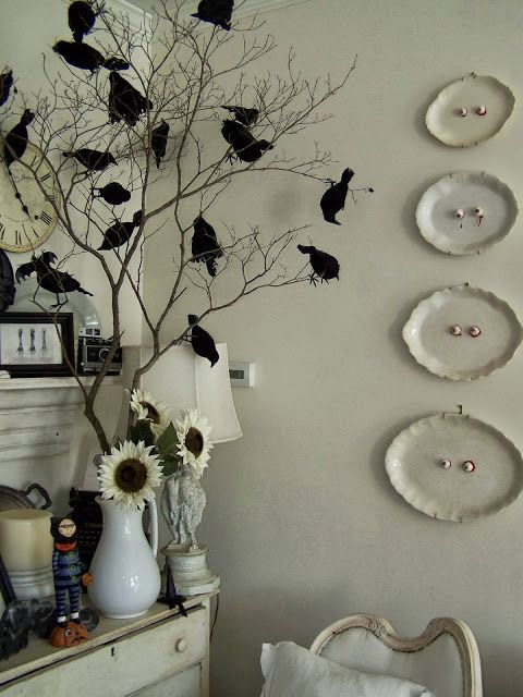 Crows on branches and eyeball on the platters are simple, yet spooky. Pinned by Pink Pad, the women's health app - pinkp.ad