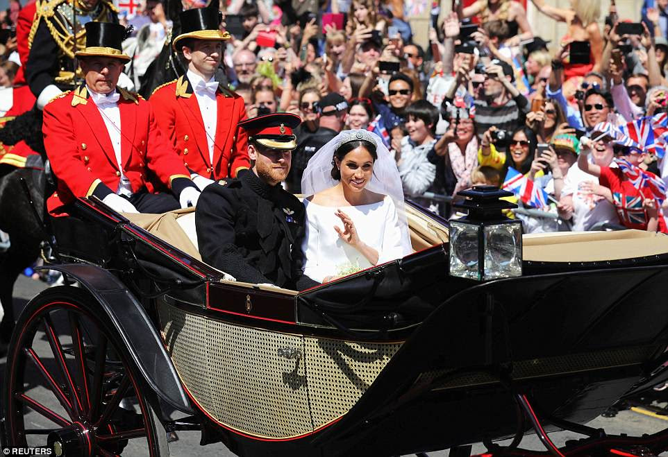 Prince Harry and his new bride Meghan Markle toured a jubilant Windsor today following the wedding ceremony