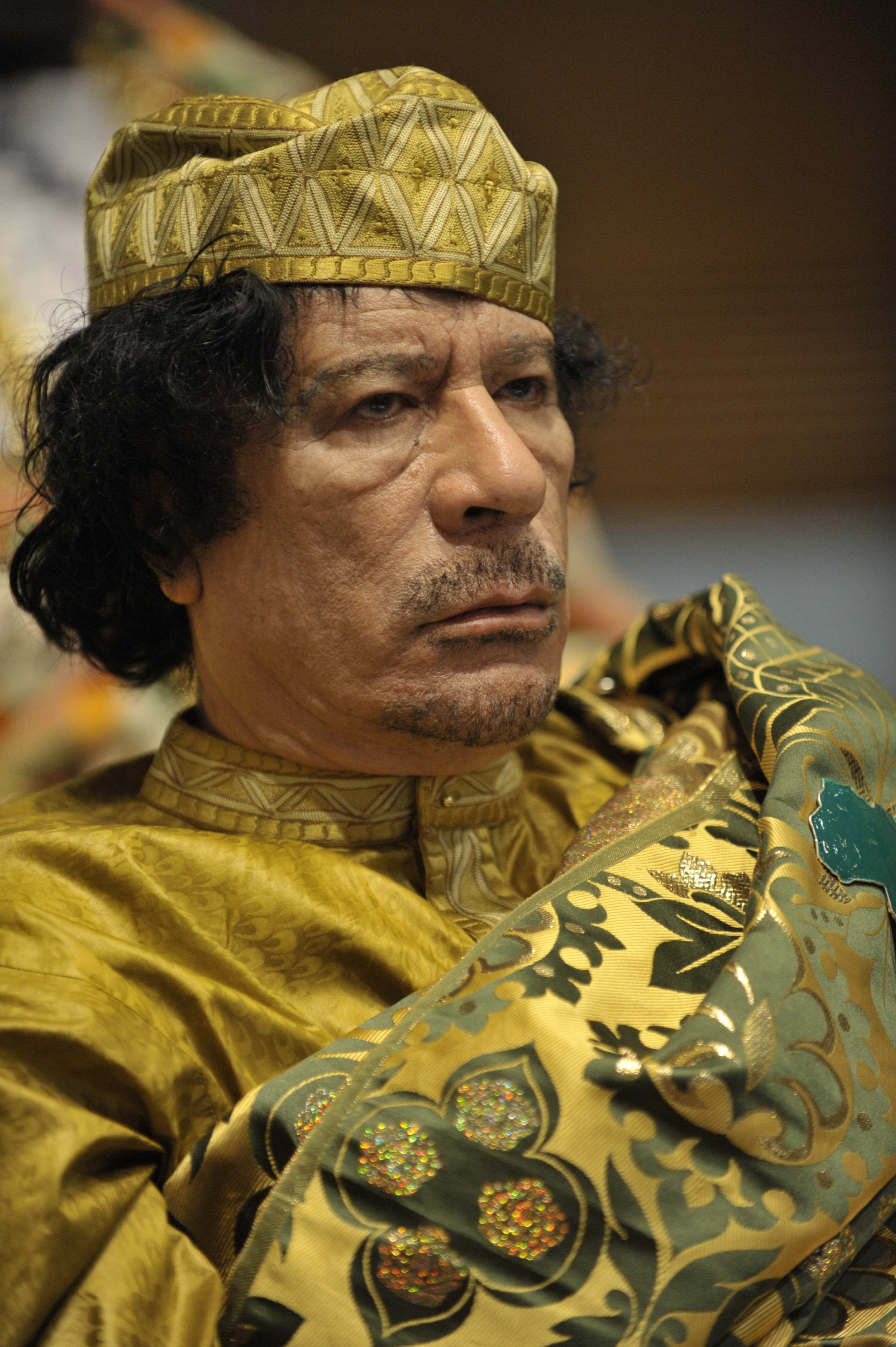 http://upload.wikimedia.org/wikipedia/commons/3/36/Muammar_al-Gaddafi_at_the_AU_summit.jpg