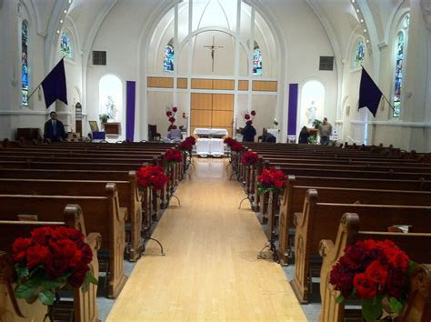 traditional church wedding decorations   red rose aisle