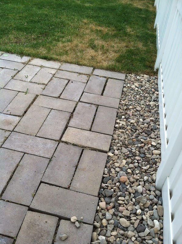 hanging out in backyard with paver stone patio