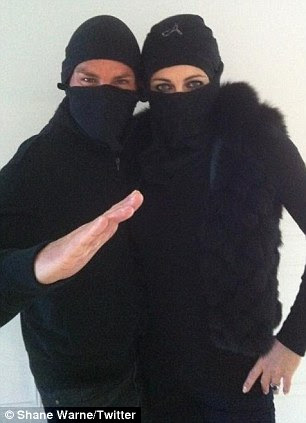 Wicked: Katherine Jenkins is a sexy devil (left), while Elizabeth Hurley and Shane Warne dressed as ninjas to go trick or treating with their children in Australia