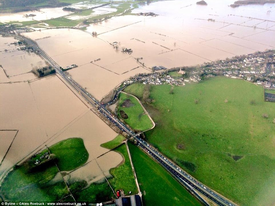 These dramatic aerial photographs show the widespread flooding in Kendal, the Lake District, left by Storm Desmond this weekend