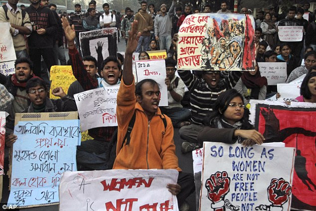 Outrage: Indian students protesting today in Kolkata against the treatment of women following the recent gang-rape of a young woman in a moving bus in New Delhi