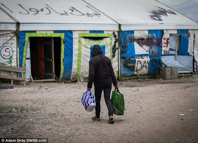 Mohamad Omar Eyman, 26, suffered fatal knife wounds late on Monday at the Norrent-Fontes camp in France's Pas-de-Calais region. Pictured: A migrant in the Calais 'Jungle' camp