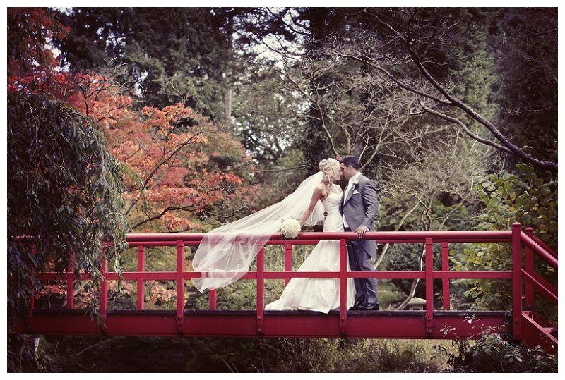 Weddings at Fanhams Hall 16, Couple on Fanhams red bridge