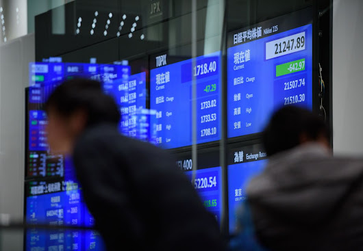 Stocks in Japan Trade Mixed; Dollar Holds Gains: Markets Wrap