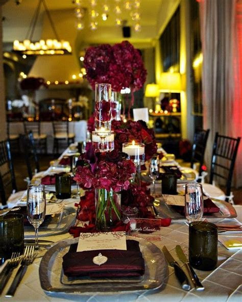 Burgandy flowers and candles for a modern centerpiece