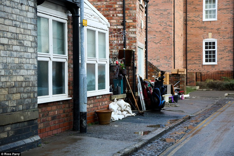 Debris: A huge clear-up is under way in York as falling river levels and repairs to industrial water pumps saw many flooded streets drained