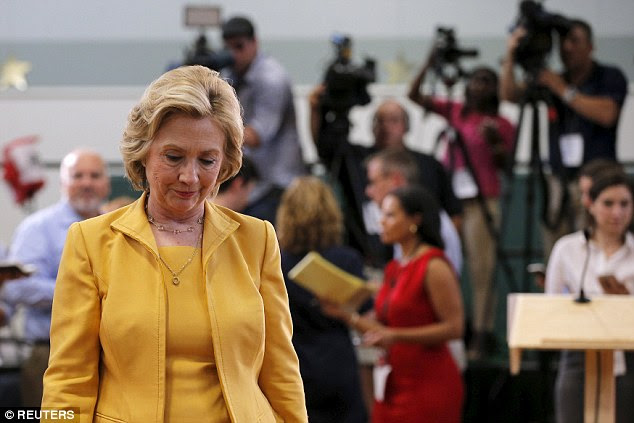 head bowed: Hillary Clinton walks away after answering questions from reporters following a town hall campaign stop in New Hampshire