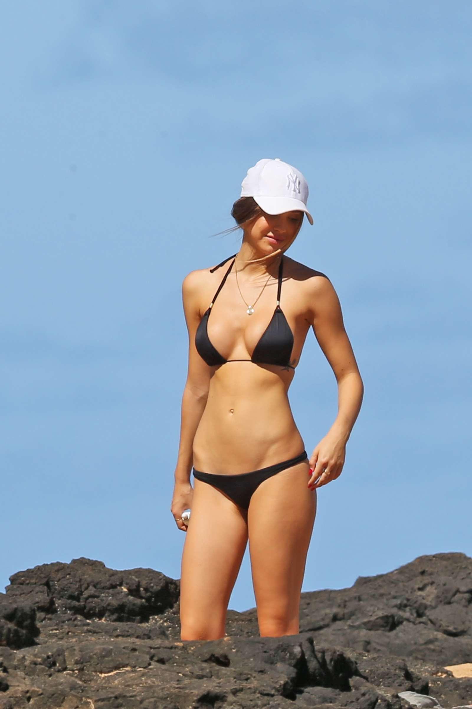 Alexis Ren in Black Bikini at a beach in Hawaii