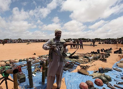 An Al Shabaab member with weapons believed to be taken from Burundian peacekeepers during a battle last week.
