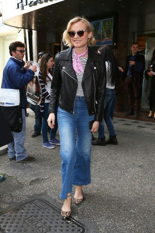 Le Fashion Blog Diane Kruger Casual Outfit Cat Eye Glasses Leather Jacket Striped T Shirt Cropped Flare Jeans Leopard Print Flats Via Harpers Bazaar